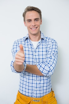 Portrait of a handyman gesturing thumbs up