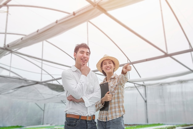 Portrait of happiness asian woman farmer and asian business man in success position