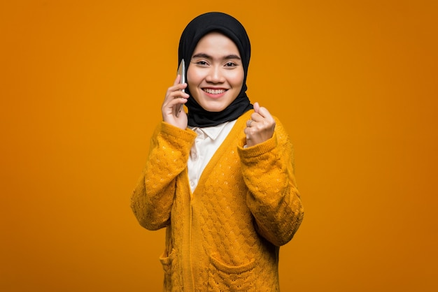 Portrait of happiness beautiful asian woman talking with a friend on mobile phone
