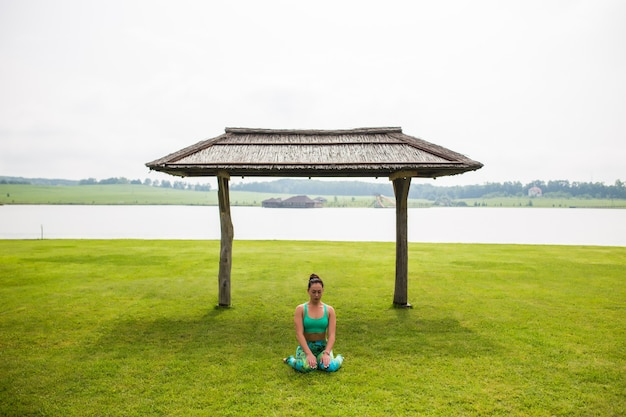 Portrait of happiness young woman practicing yoga on outdoors