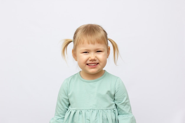 Portrait of happy 4 years old girl isolated on gray background