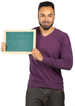 Portrait of a happy afro american man holding blank board isolated on a white