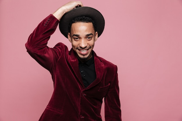 Portrait of a happy afro american man in stylish cloth posing