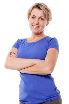 Portrait of happy aged sportswoman