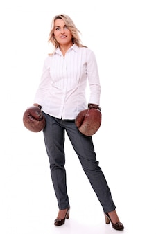Portrait of happy aged woman with boxing gloves
