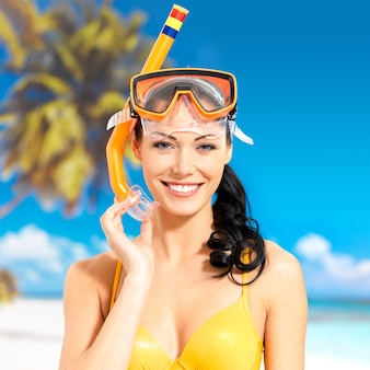 Portrait of the happy beautiful woman enjoying at beach.