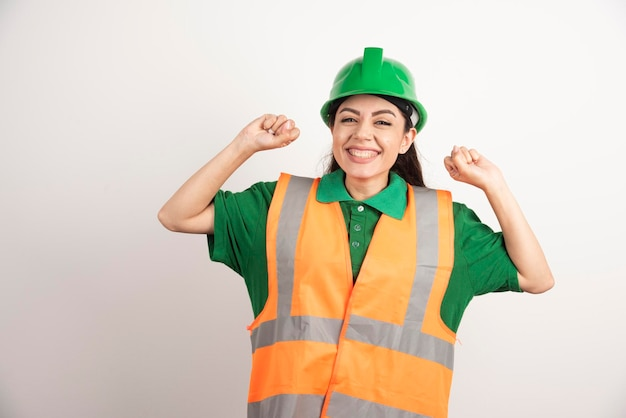 Portrait of happy business woman in builder helmet. high quality photo