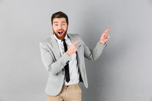 Portrait of a happy businessman dressed in suit