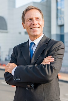 Portrait of a happy businessman with crossed arms