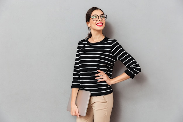 Portrait of a happy businesswoman in eyeglasses