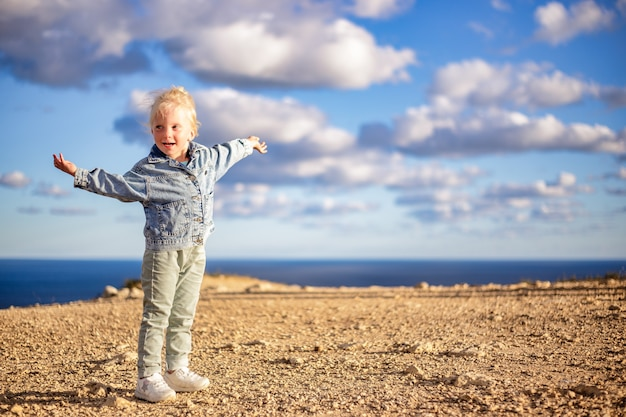 Portrait of happy child on the beach summer vacation concept