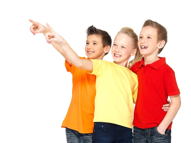 Portrait of the happy children point by finger on something away -  isolated on white