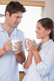 Portrait of a happy couple drinking coffee