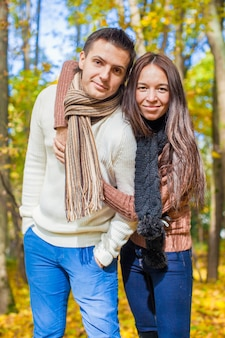 Portrait of happy couple in love on autumn sunny fall day