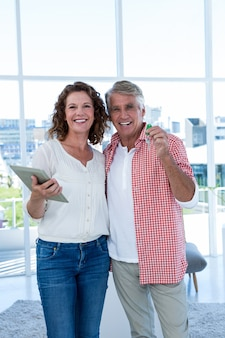 Portrait of happy couple standing at home