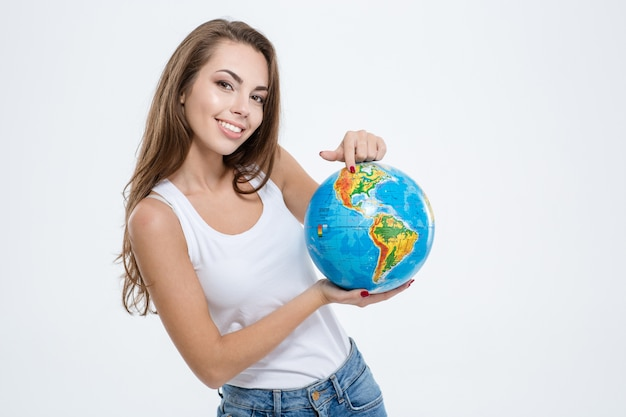 Portrait of a happy cute woman holding globe isolated on a white background