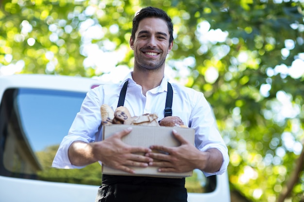 Portrait of happy delivery person