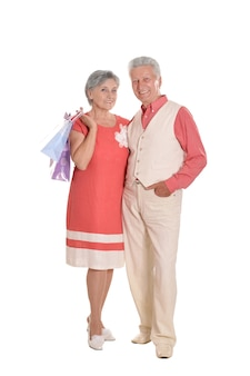 Portrait of a happy elderly couple and shopping bags