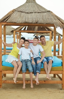 Portrait of a happy family having lunch on beach