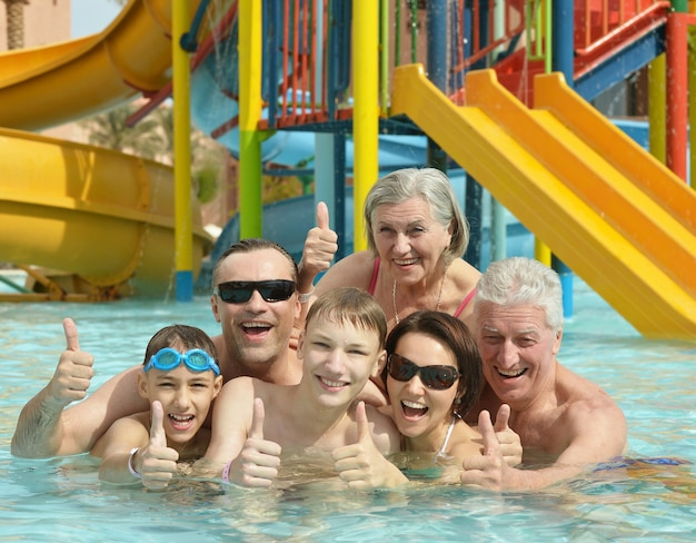 Portrait of happy family relax in the pool