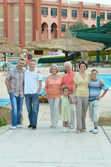 Portrait of happy family relaxing at vacation resort