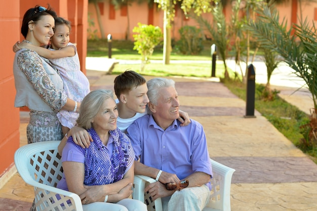 Portrait of a happy family relaxing at vacation resort