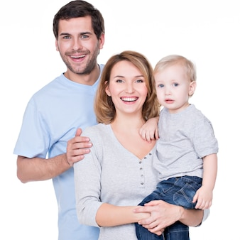 Portrait of the happy family with little baby standing