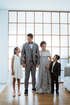 Portrait of a happy family with modern clothes