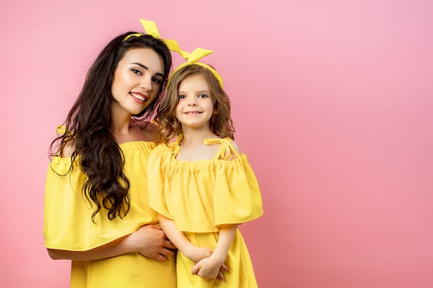Portrait of happy family in yellow clothing with sunglasses
