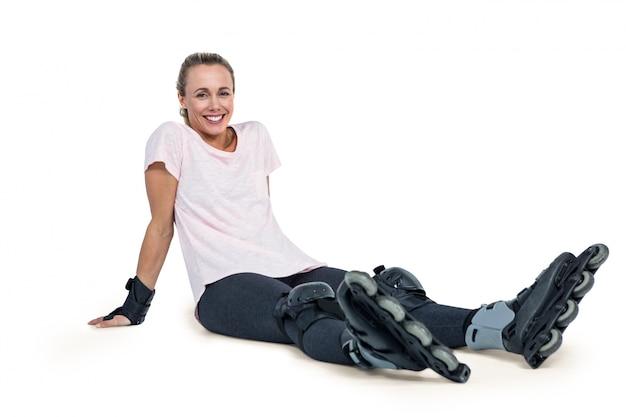 Portrait of happy female inline skater relaxing