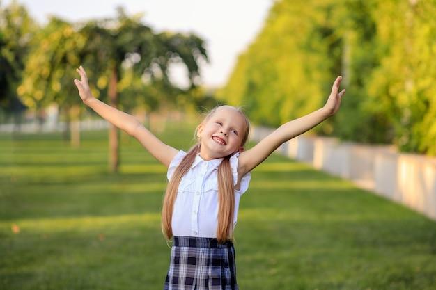 Portrait of a happy first grader schoolgirl