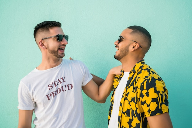 Portrait of happy gay couple spending good time together in the street