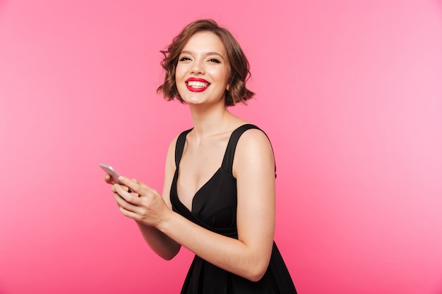 Portrait of a happy girl dressed in black dress