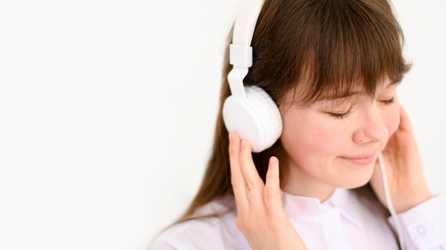 Portrait of happy girl listening to music