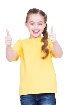 Portrait of happy girl showing thumbs up gesture in yellow t-shirt, isolated over white background.