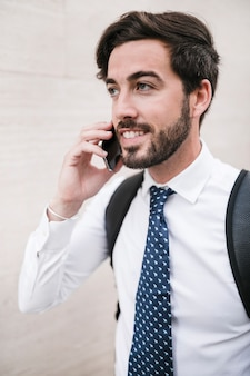 Portrait of a happy handsome man talking on cellphone