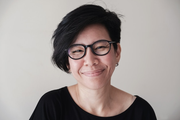 Portrait of happy and healthy natural looking middle aged asian woman