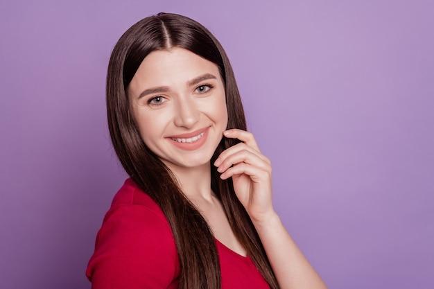 Portrait of happy joyful dreamy adorable woman look camera shiny smile on purple background