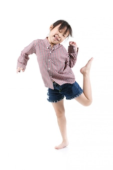 Portrait of happy little asian child jumping isolated on white
