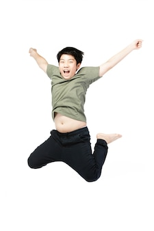 Portrait of happy little asian child jumping isolated