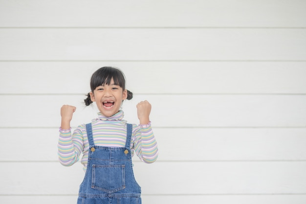 Portrait of happy little asian child  on white background