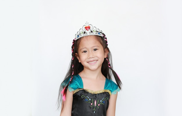 Portrait of happy little asian girl dressed with a fantasy outfit