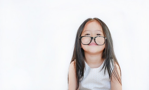 Portrait of happy little girl with glasses on white background.