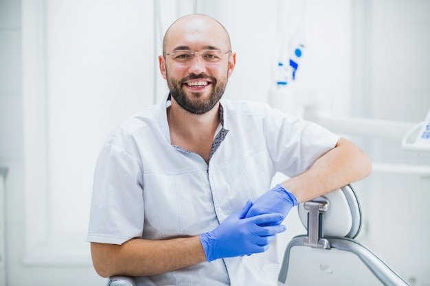 Portrait of a happy male dentist