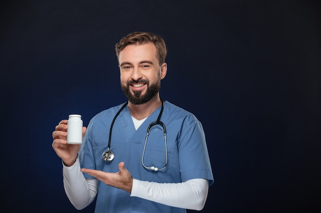 Portrait of a happy male doctor dressed in uniform
