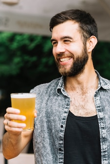 Portrait of a happy man enjoying the glass of beer