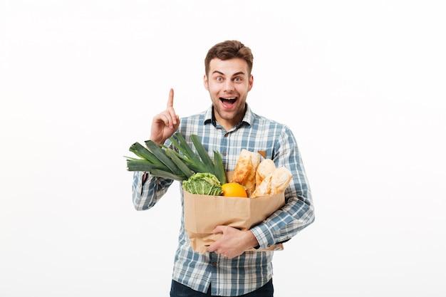 Portrait of a happy man holding paper bag