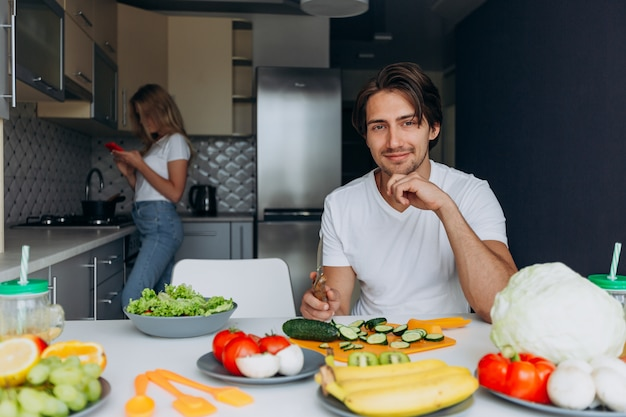 Portrait of happy man at the table prepared healthy food.