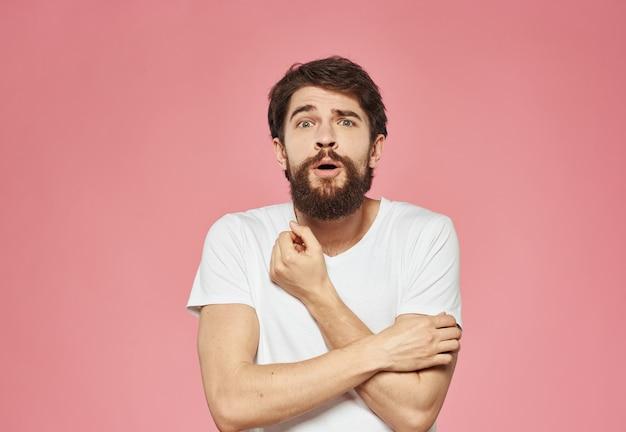 Portrait of happy man with bushy beard emotions model pink background. high quality photo