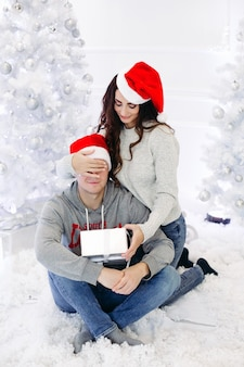 Portrait of happy married couple at christmas